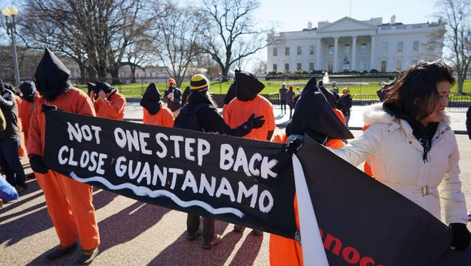 Demonstrators take part in a protest calling for the closure of the Guantanamo Bay prison on January 11, 2016 in front of the White House.