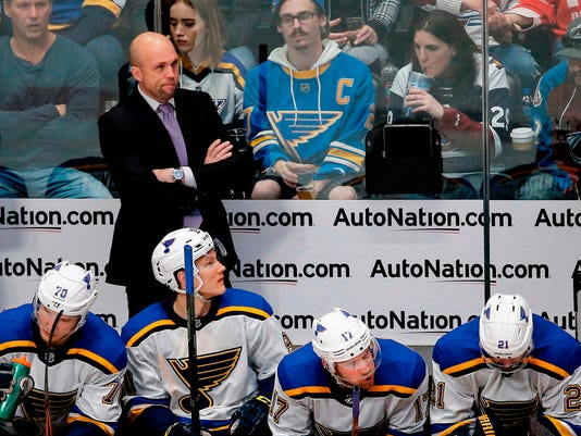 FILE - In this April 7, 2018, file photo, St. Louis Blues coach Mike Yeo watches during the third period of the team's NHL hockey game against the Colorado Avalanche in Denver.  After a season-ending loss put an end to their season without a playoff appearance, the St. Louis Blues and coach Mike Yeo are left looking to the future. (AP Photo/Jack Dempsey, File)