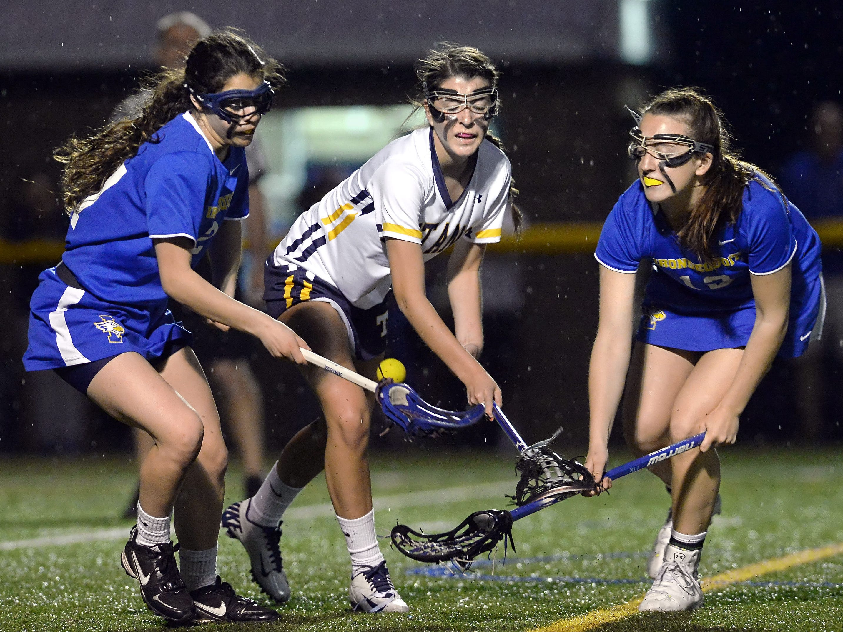 Webster Thomas' Mackenzie Travis, center, fights for the ball against Irondequoit's Jamie Rogers, left, and Ari Torpey.