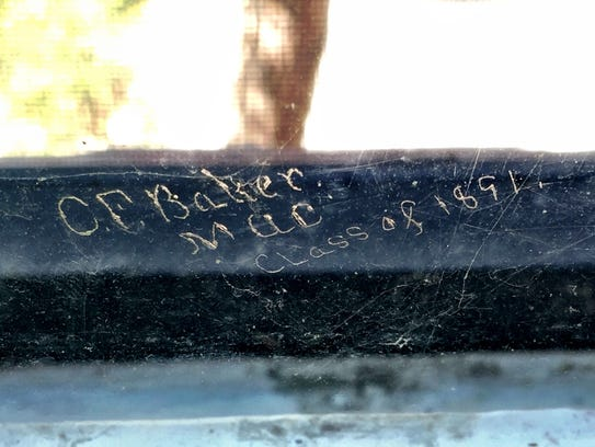 A carving reading C.F. Baker MAC Class of 1891, etched onto a windowsill inside Michigan State University's Linton Hall.