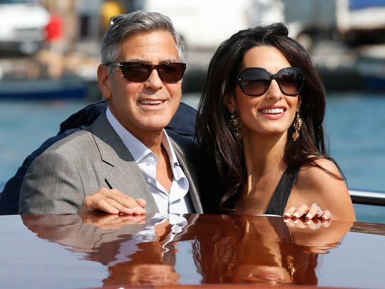 In this Sept. 26, 2014 file photo, George Clooney, left, and Amal Alamuddin arrive in Venice, Italy. Clooney, 53, and Alamuddin, 36, married in Venice, one of the world's most romantic settings.