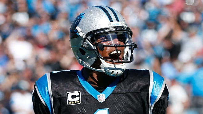 Carolina Panthers quarterback Cam Newton (1) celebrates after a touchdown in the second quarter against the Arizona Cardinals at Bank of America Stadium.