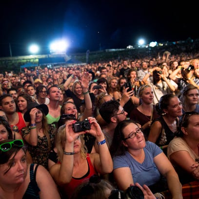 Fans watch as Edward Sharpe & the Magnetic Zeros perform
