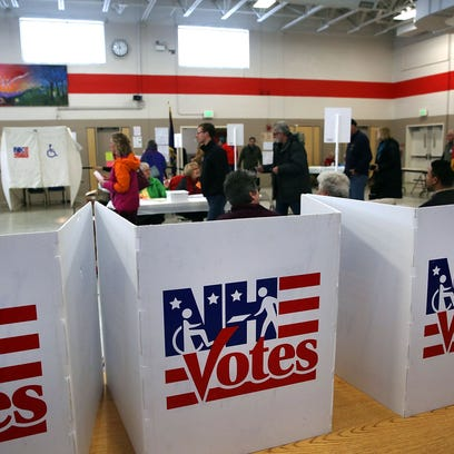 People vote inside of a middle school serving as a