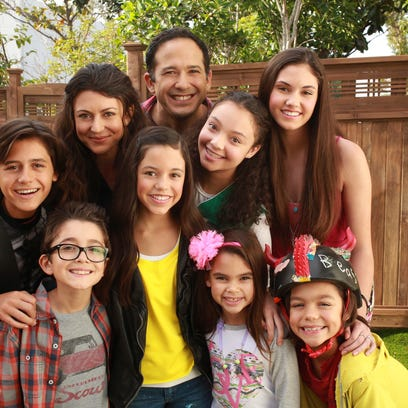 Jenna Ortega, (standing in the middle wearing a yellow