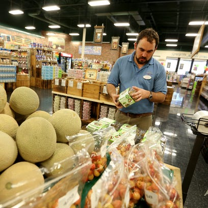 Ben Klopf, animal care manager, shops for produce at