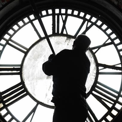 Working behind one of the four clock faces on the Old