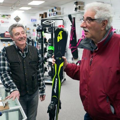 Cliff Conger, left, chats with customer Neisen Luks,