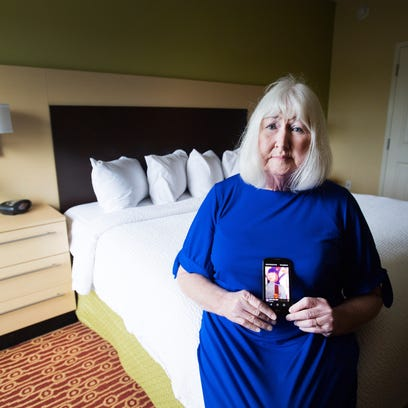 Brenda Bryant holds a photograph of her daughter when