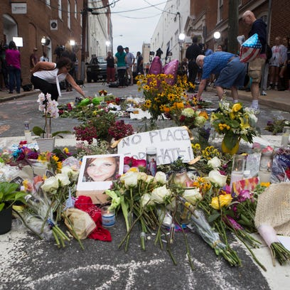 The memorial on 4th street is built up with more flowers