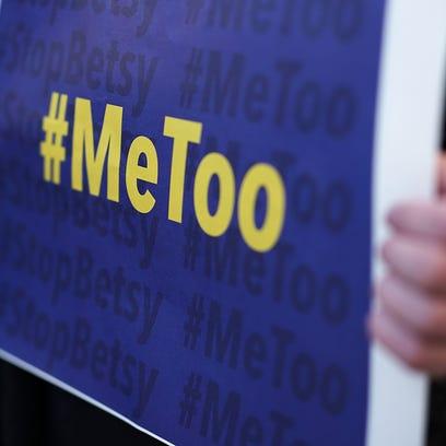 WASHINGTON, DC - JANUARY 25:  An activist holds a #MeToo