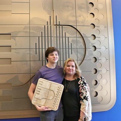 Reuben and Rhonda Egan stand in front of new artwork