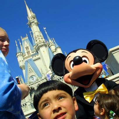 The Walt Disney character Mickey Mouse greets children