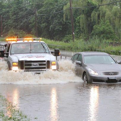 A flash flood on the Taconic State Parkway shown in