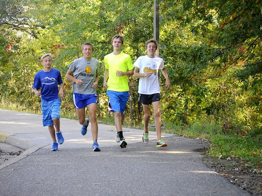 Sartell cross country sophomores Patrick Hesse, David