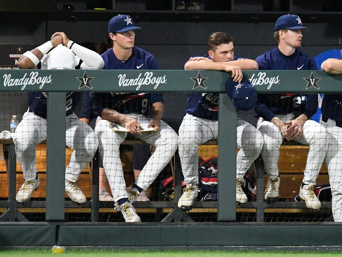 Vanderbilt players sit dejectedly as the team loses
