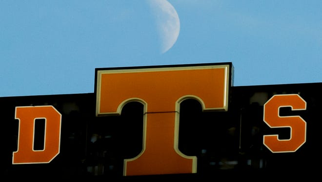 The moon rises behind the scoreboard during a game between Tennessee and Vanderbilt on Nov. 25.