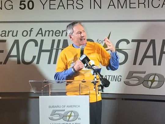 Subaru President Thomas Doll addresses workers at the Cherry Hill firm's 50th anniversary celebration last month.