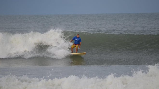 Cocoa Beach City Commissioner Ben Malik catches a back side wave at his favorite south Cocoa Beach break.