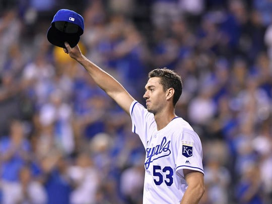 Royals pitcher Eric Skoglund acknowledges the cheers of the crowd as he is relieved in the sixth inning after making his major league debut in the Tigers' 1-0 loss Tuesday in Kansas City, Mo.
