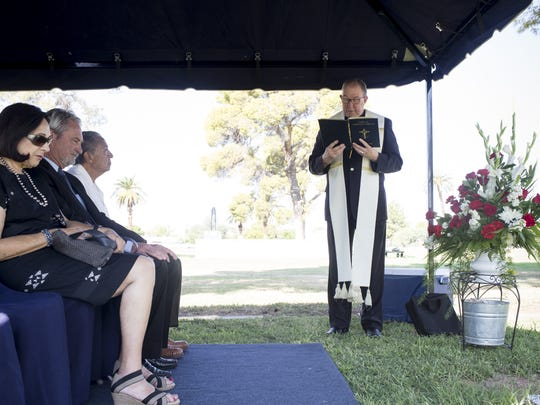 The Rev. Dan Sullivan says a prayer during a headstone unveiling ceremony for Gov. Rose Mofford on Friday. Mofford died on Sept. 15, 2016.