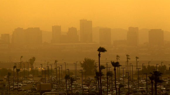 A look of downtown Phoenix as a dust storm moves in as seen at Phoenix Sky Harbor International Airport on Friday, July 25, 2014.