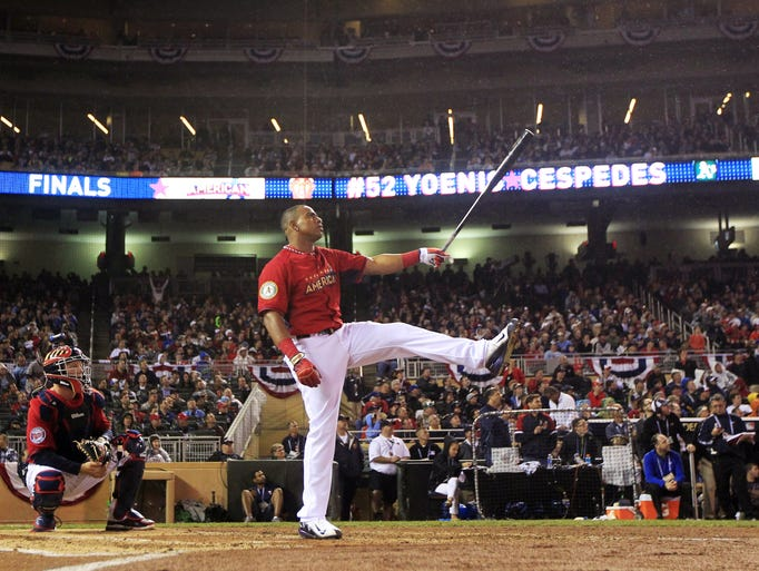 American League's Yoenis Cespedes, of the Oakland Athletics, reacts during the final round of the MLB All-Star baseball Home Run Derby, Monday, July 14, 2014, in Minneapolis. Cespedes defeated National League's Todd Frazier, of the Cincinnati Reds, in the finals. (AP Photo/Jeff Roberson)