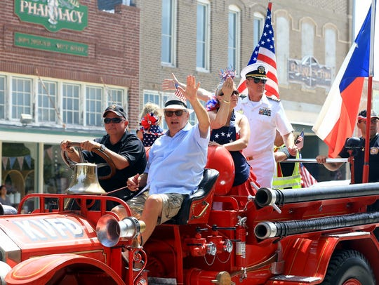 Mayor Sam Fugate from Kingsville waves at the crowd