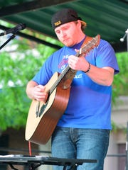 """Former """"American Idol"""" contestant, Ben Briley, plays for more than 1,500 people on the square in Gallatin on Thursday."""