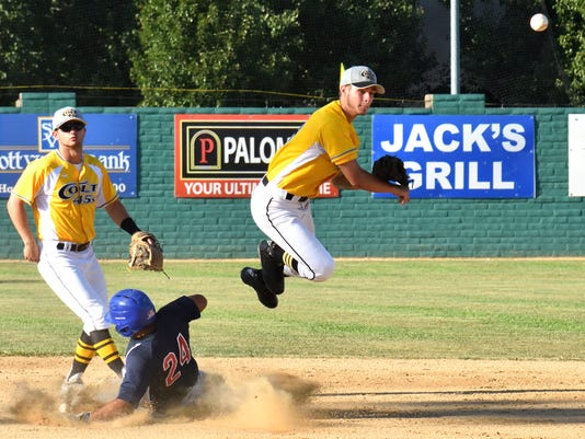 Colt-45s-July-2-Austin-Lively-leaps-over-Fairfield-s-Jo-Jo-Quintanilla-to-complete-second-inning-double-play.-Taylor-Angley-in-background..jpg