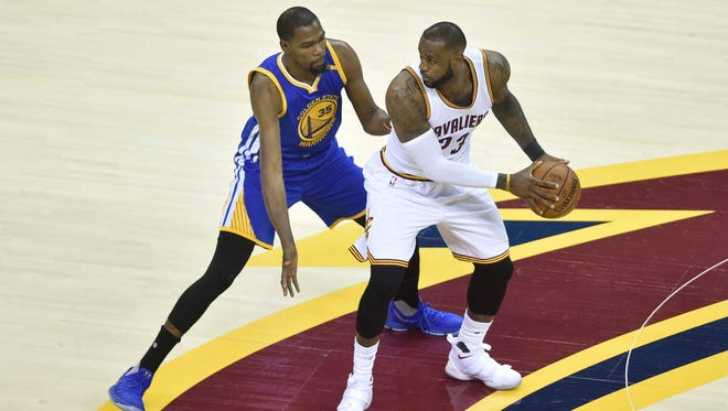 LeBron James works around Kevin Durant during the first quarter of Game 3 of the 2017 NBA Finals.