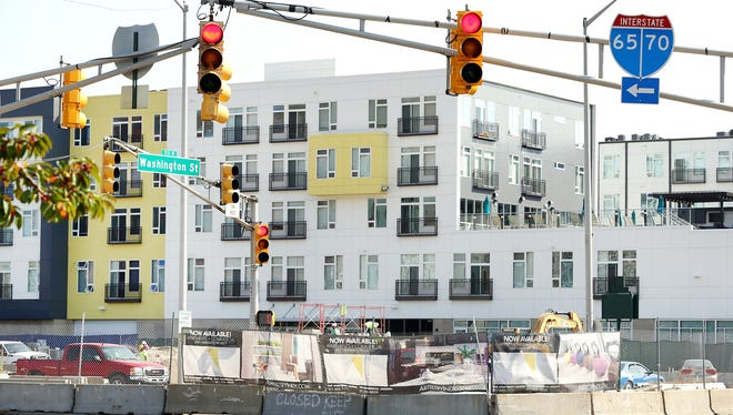 Workers with Milhaus Construction continue to work on the new Artistry apartment complex expansion at 451 East Market Street on Oct. 1, 2014, as it comes all the way up to Washington Street.