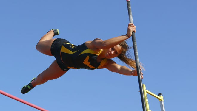 Colonel Crawford's Callie Ruffener clears 11-6 to win a Division III district pole vault title Thursday at Bucyrus High School.