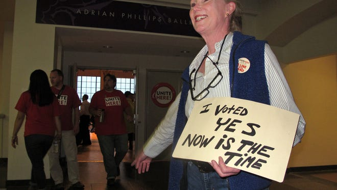Ruthann Joyce directs members of Local 54 of the Unite-HERE union to a voting room Thursday in Atlantic City.