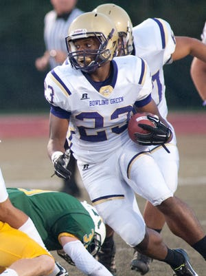 Bowling Green Purple running back Jamale Carothers runs for a 1st down.