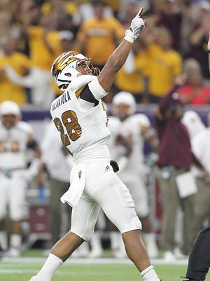 Sep 5, 2015: Arizona State Sun Devils linebacker Viliami Moeakiola (28) celebrates his sack against Texas A&M Aggies quarterback Kyle Allen (10) (not pictured) in the first quarter at NRG Stadium.