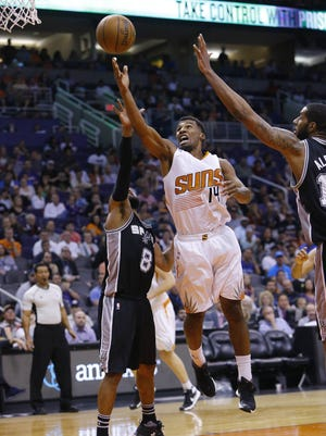 Phoenix Suns guard Ronnie Price (14) shoots against San Antonio Spurs guard Tony Parker (9) in the second half of their NBA game Sunday, Feb. 21,  2016 in Phoenix, Ariz