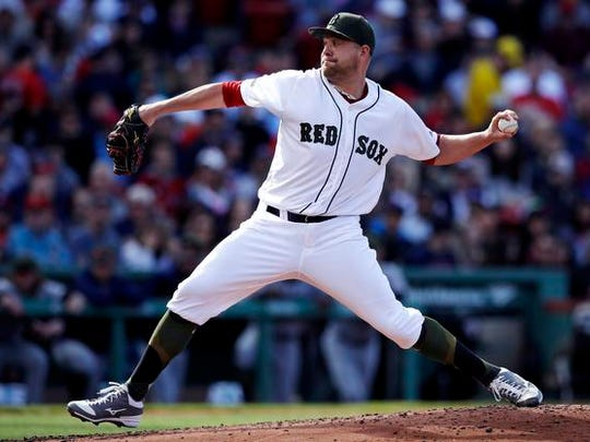Boston Red Sox starting pitcher Brian Johnson delivers during the third inning of a baseball game against the Seattle Mariners at Fenway Park in Boston, Saturday, May 27, 2017. (AP Photo/Charles Krupa)
