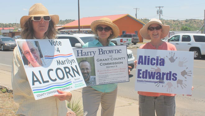 Jennifer Bjornstad, Sally Smith, and Alicia Edwards campaign along highway 180 as voters go to the Silver City Women's club to vote.