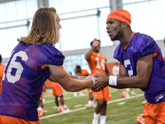 Clemson quarterback Trevor Lawrence (16), left, and quarterback Kelly Bryant (2) greet each other during the first day of practice at the Clemson Indoor Football facility at Clemson on Friday, August 3, 2018.
