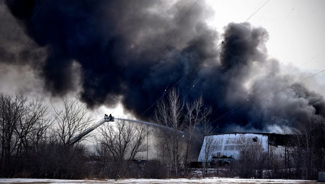 Thick smoke billows over firefighters Thursday, Jan. 26, at Rock On Trucks Inc. in Waite Park. Public Relations spokesperson Lady Jayne Fontaine said the company is determined to rebuild.
