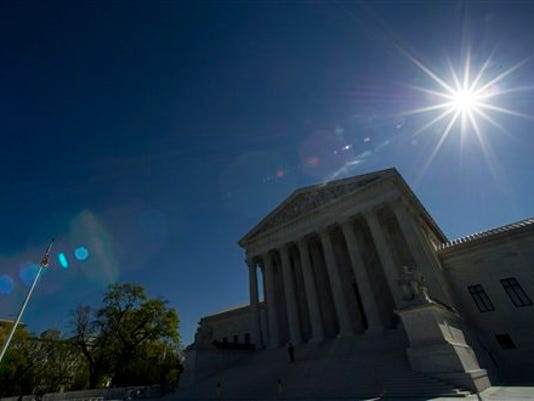 The sun shines over the Supreme Court as they hold a hearing on same-sex marriage, in Washington, Tuesday, April 28, 2015.