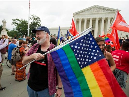 Supporters celebrate outside the Supreme Court in June after the court declared that same-sex couples have a right to marry anywhere in the United States. A judge's recent decision in Pennsylvania declared a same-sex couple as common-law married even though one partner died before it was legal in the state.