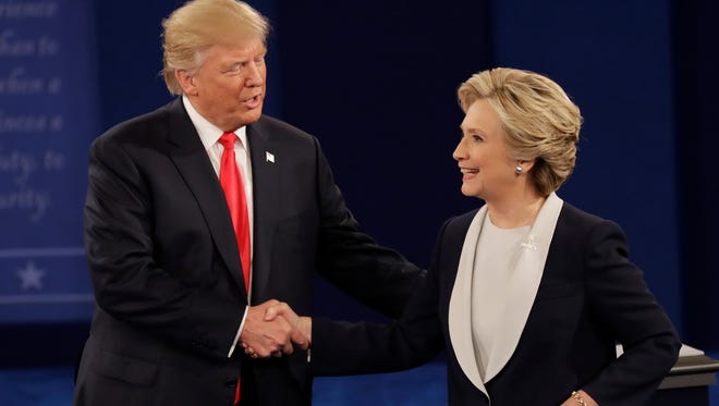 Republican presidential nominee Donald Trump shakes hands with Democratic presidential nominee Hillary Clinton following the second presidential debate at Washington University in St. Louis, Sunday, Oct. 9, 2016.