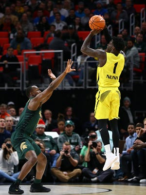 Oakland's Kendrick shoots a 3-pointer over Joshua Langford during Saturday's game at Little Caesars Arena. Nunn finished with 32 points.