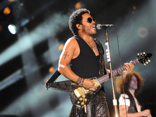 Lenny Kravitz performs at LP Field for the Saturday night series of concerts at the 2013 CMA Music Festival.