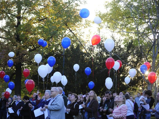 At least 50 people gathered to remember Harry Smith in Yoctangee Park on the one-year anniversary of his murder.