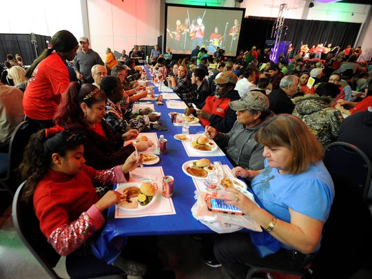 Diners eat their meals together during the HEB Feast of Sharing on Tuesday, Dec. 6, 2016, at the Abilene Civic Center.
