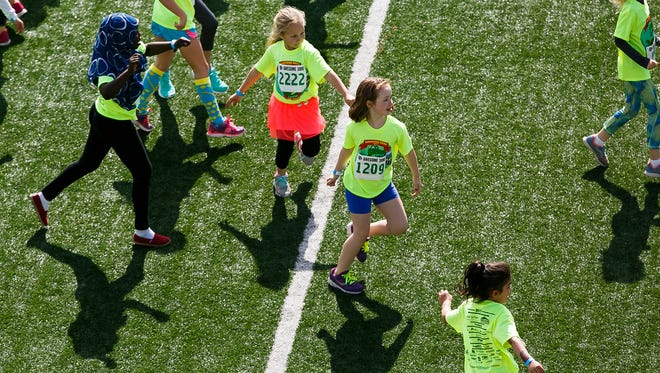 Second graders warm up for their race at the 35th annual Awesome 3000 on Saturday, May 6, 2017, at McCulloch Stadium in Salem, Ore.