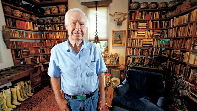 In this July 4, 2014 photo, Forrest Fenn poses at his Santa Fe, N.M., home.
